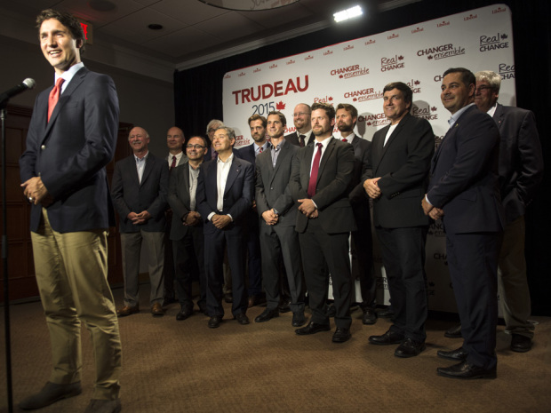 Liberal leader Justin Trudeau stands before a group of  local candidates during a news conference Wednesday, September 2, 2015 in Quebec City. THE CANADIAN PRESS/Paul Chiasson